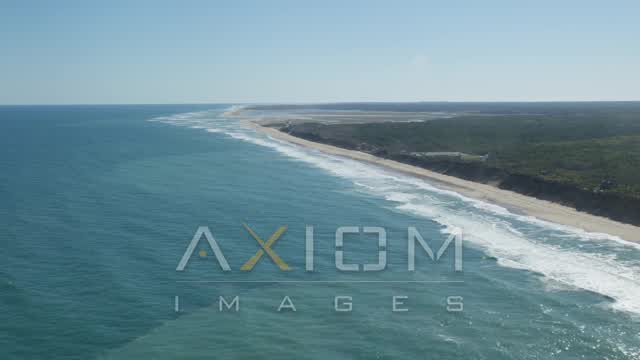 Pan right, fly by beaches, Nauset Lighthouse, Eastham, Massachusetts Aerial Stock Footage | AX144_030