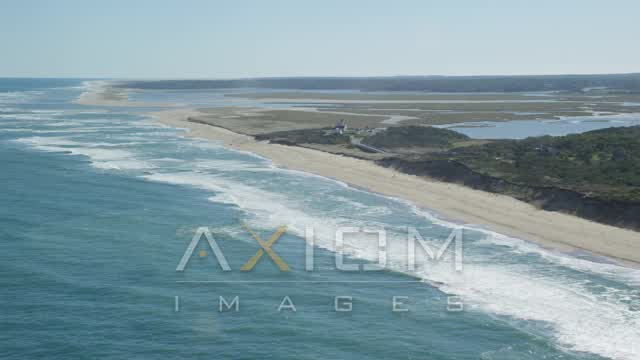 Pan right by Coast Guard Beach, Cape Cod, Eastham, Massachusetts Aerial Stock Footage | AX144_031
