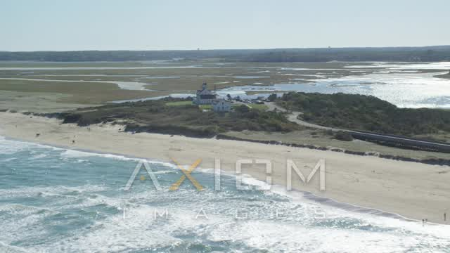 Flying by waves rolling onto beaches, Coast Guard Beach, Eastham, Massachusetts Aerial Stock Footage | AX144_032