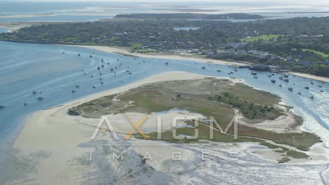 Fly over Strong Island, approaching small coastal town, Chatham, Massachusetts Aerial Stock Footage AX144_046