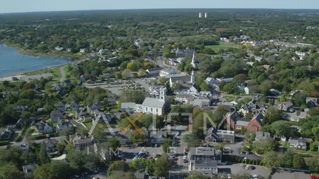 Flying by small coastal town, churches, Cape Cod, Chatham, Massachusetts Aerial Stock Footage | AX144_050
