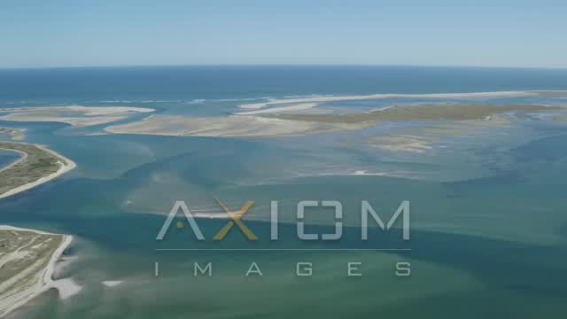 Flying by North Monomoy Island, sand bars, Chatham, Massachusetts Aerial Stock Footage | AX144_055