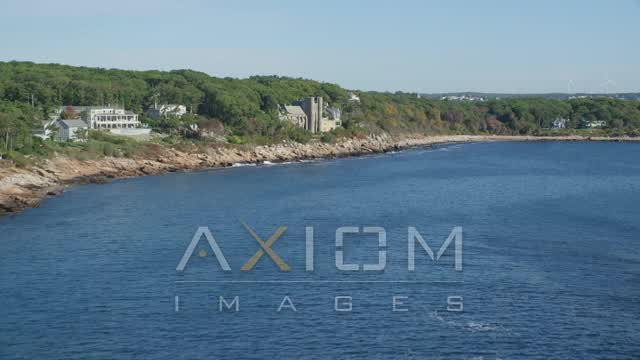 Flying by Hammond Castle, rocky coastline, Gloucester, Massachusetts Aerial Stock Footage | AX147_081
