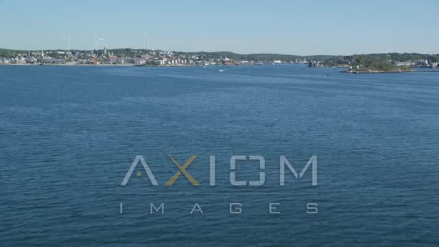 Fly low over Gloucester Harbor, approach coastal town, Gloucester, Massachusetts Aerial Stock Footage | AX147_084