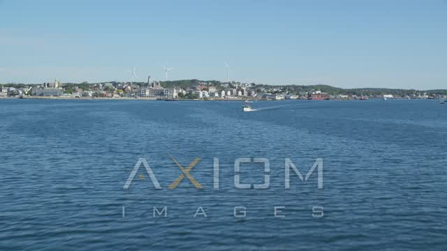 Fly low over harbor, approaching coastal town, Gloucester, Massachusetts Aerial Stock Footage | AX147_085