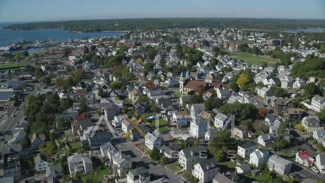Flying over coastal town, colorful trees, Gloucester, Massachusetts Aerial Stock Footage | AX147_092