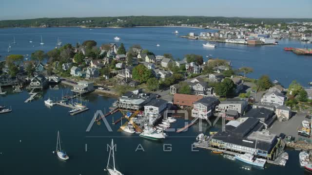 Flying by a small coastal town and harbor, Gloucester, Massachusetts Aerial Stock Footage | AX147_096