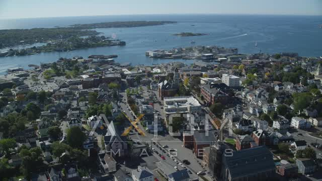 Wide angle of a coastal town and city hall, Gloucester, Massachusetts Aerial Stock Footage | AX147_102
