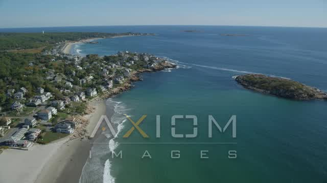 Flying by oceanfront homes, Gloucester, Massachusetts Aerial Stock Footage | AX147_108