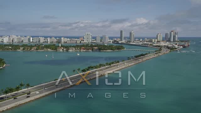 Light Traffic on the MacArthur Causeway Heading to and from South Beach, Florida Aerial Stock Footage | AX20_038