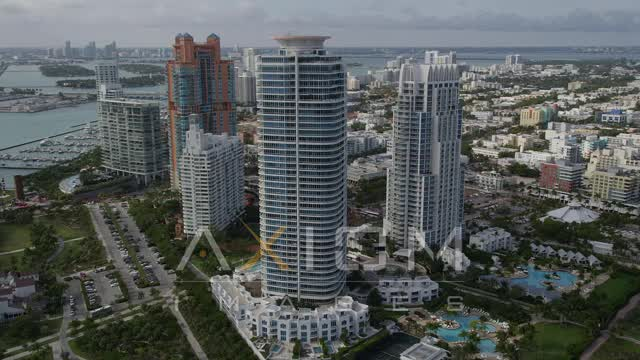Orbit Modern High-Rises on the Coast in South Beach, Florida Aerial Stock Footage | AX21_061