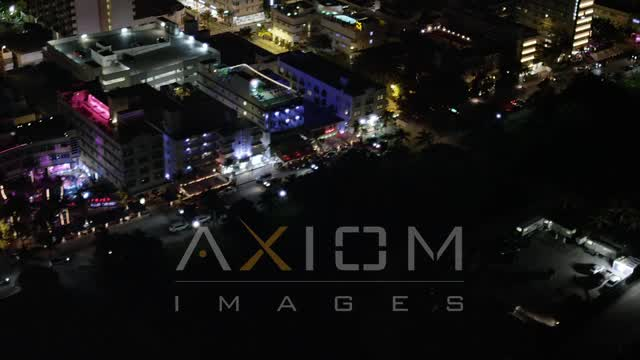 Flyby Hotels on Ocean Drive at Night in South Beach, Florida Aerial Stock Footage | AX23_077
