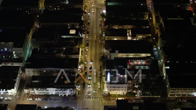 Fly Over Traffic on Collins Avenue at Night through South Beach Aerial Stock Footage | AX23_115