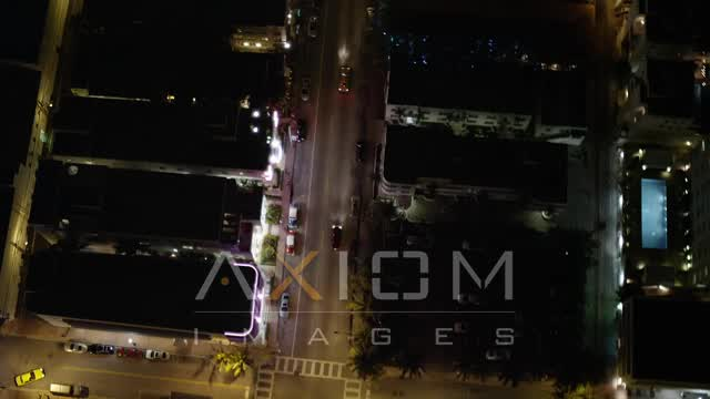 Bird's Eye View of a Street through South Beach at Night Aerial Stock Footage | AX23_117