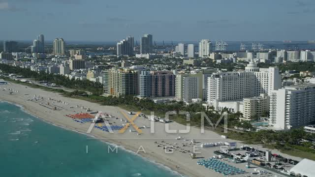 Flying along the shore of South Beach, tilt down, Miami Beach, Florida Aerial Stock Footage | AX24_093