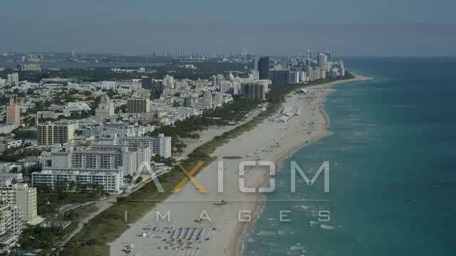 Flying inland from South Beach coastline, reveal skyscrapers, Miami Beach, Florida Aerial Stock Footage | AX24_114