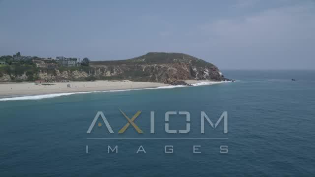 Orbit the rugged cliffs of Point Dume, Malibu, California Aerial Stock Footage | AX42_087