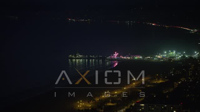 Santa Monica Pier and ferris wheel, California night Aerial Stock Footage | AX64_0297