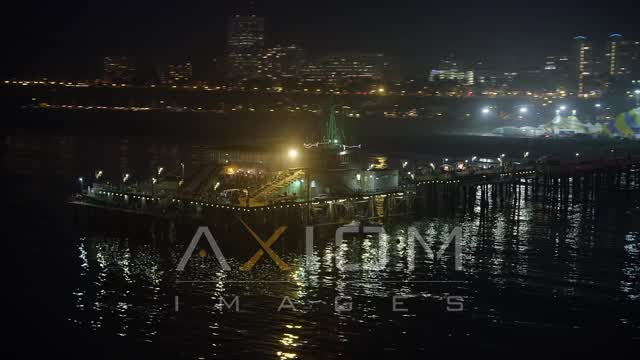 End of Santa Monica Pier, California night Aerial Stock Footage | AX64_0302