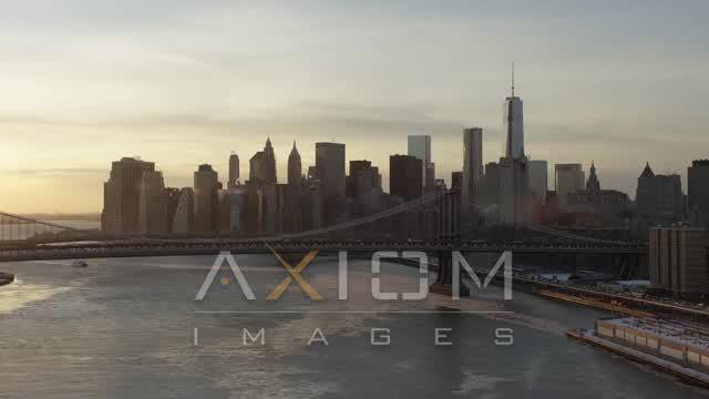 Manhattan Bridge and Lower Manhattan skyline, New York City Sunset Aerial Stock Footage AX66_0232