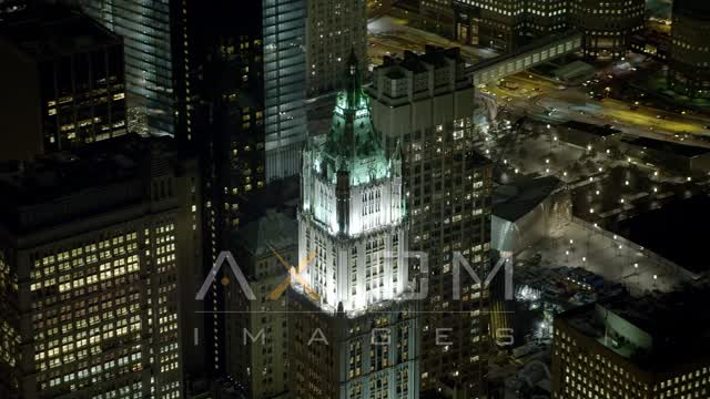 Flying by top of Woolworth Building at night, New York Aerial Stock Footage | AX67_089