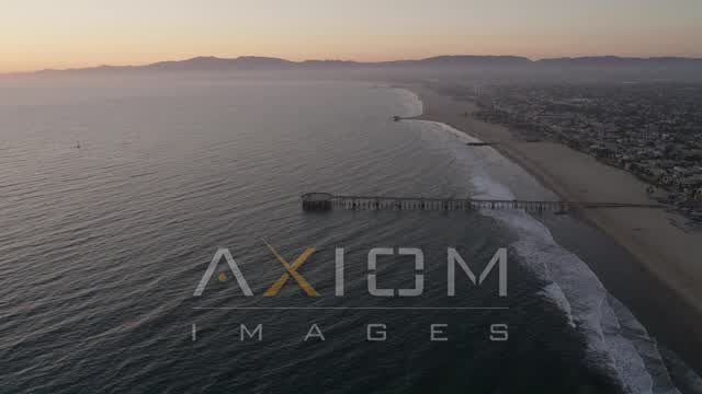 Approach the Venice Fishing Pier on the Coast at Sunset Aerial Stock Footage | AX69_024