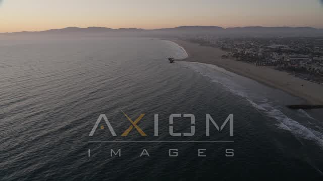 Tilt to Reveal Venice Fishing Pier and Beach to Santa Monica at Sunset Aerial Stock Footage | AX69_025