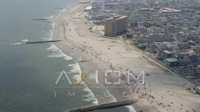 Beach goers on the beach in Ocean City, New Jersey Aerial Stock Footage | AX71_218