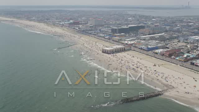 Beach goers on a crowded beach in Ocean City, New Jersey Aerial Stock Footage | AX71_220