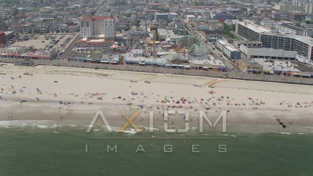 Beach goers near Playland's Castaway Cove, Ocean City, New Jersey Aerial Stock Footage | AX71_222