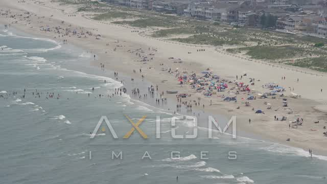 Beach goers on crowded beach in Ocean City, New Jersey Aerial Stock Footage | AX71_227