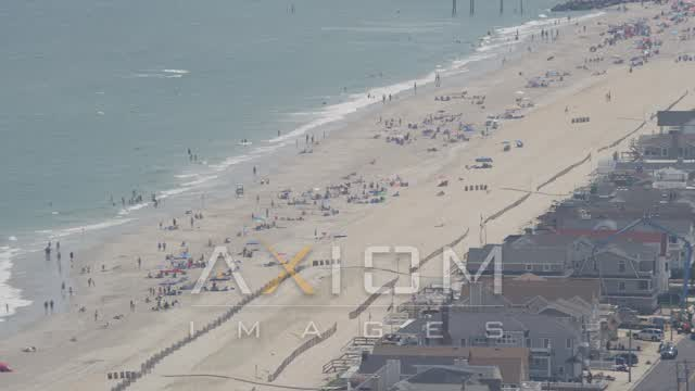 Sunbathers in Ocean City, New Jersey Aerial Stock Footage | AX71_232