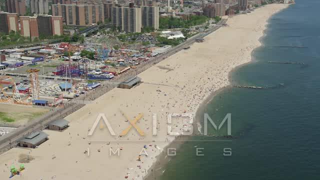 Fly away from Luna Park and Coney Island Beach, Brooklyn Aerial Stock Footage | AX83_221