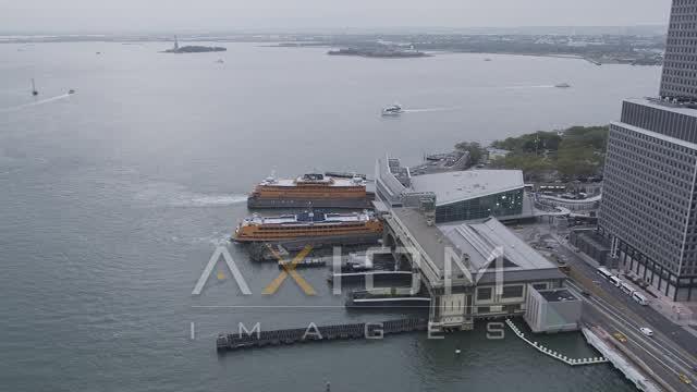 Flying by Staten Island Ferries, Lower Manhattan, New York, New York Aerial Stock Footage | AX84_109