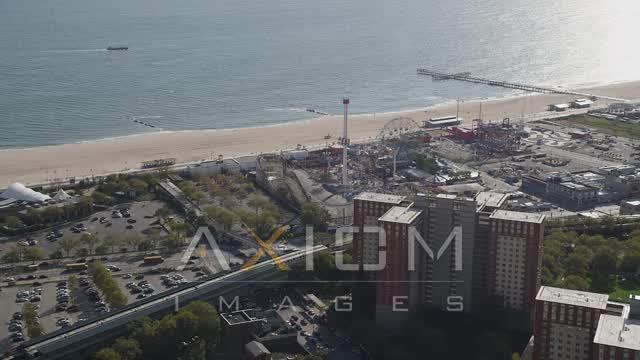Approaching Luna Park, Coney Island, Brooklyn, New York City, New York Aerial Stock Footage | AX88_043