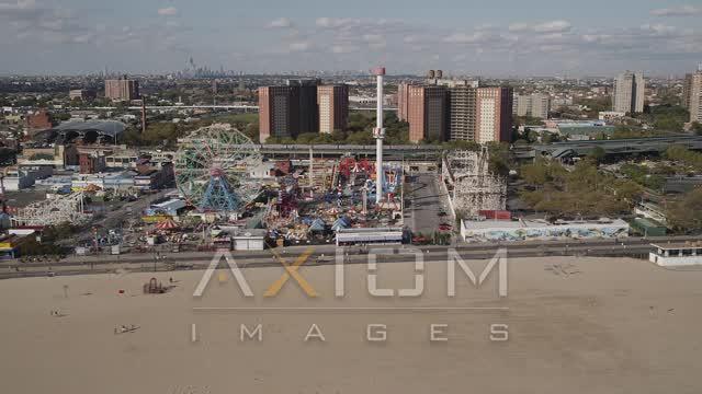 Fly by roller coaster, Ferris wheel, Luna Park, Coney Island, Brooklyn, New York  Aerial Stock Footage | AX88_047