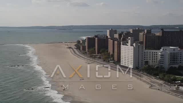 Flying by Coney Island Beach, apartments, Brooklyn, New York, New York Aerial Stock Footage | AX88_051
