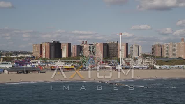 Flying by Luna Park, Coney Island Beach, Brooklyn, New York, New York Aerial Stock Footage AX88_055