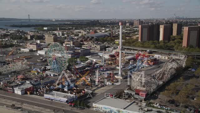 Flying by Luna Park, Coney Island, Brooklyn, New York, New York Aerial Stock Footage | AX88_056