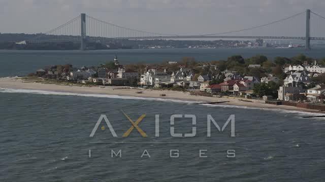 Flying by beachfront homes, Coney Island, Brooklyn, New York, New York Aerial Stock Footage | AX88_066