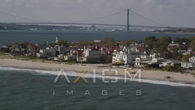 Flying by beachfront homes, Coney Island, Brooklyn, New York, New York Aerial Stock Footage | AX88_068