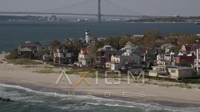 Flying by beachfront homes, Coney Island, Brooklyn, New York, New York Aerial Stock Footage | AX88_069