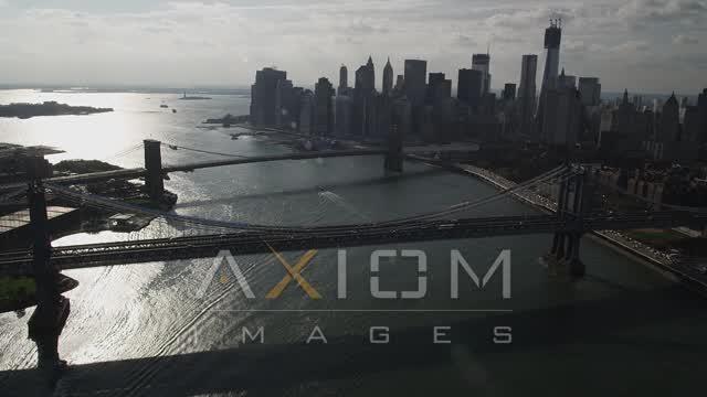 East River, reveal Brooklyn Bridge, Manhattan Bridge, Lower Manhattan, New York Aerial Stock Footage | AX88_124
