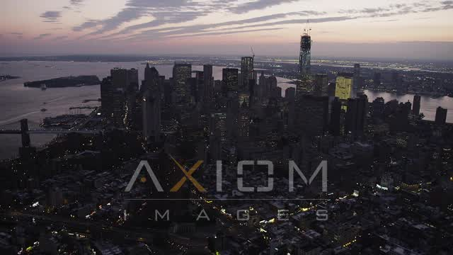 Flying by Lower Manhattan, seen from Lower East Side, New York, sunset Aerial Stock Footage | AX89_104