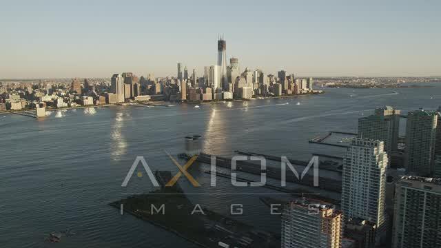 Lower Manhattan, across the Hudson River, New York, New York, sunset Aerial Stock Footage | AX93_002