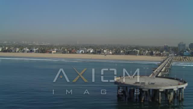 Flying over ocean, along coastline, reveal Venice Fishing Pier, Venice, California Aerial Stock Footage | DCA05_075