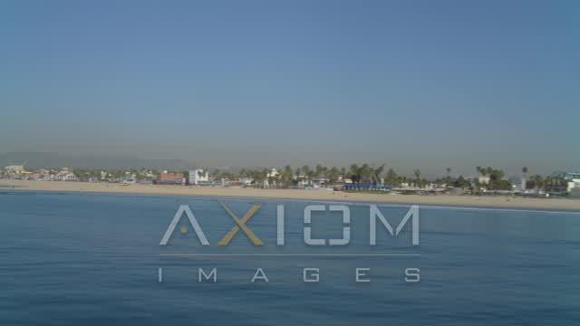 Flying low over ocean, by coastline, Venice, California Aerial Stock Footage | DCA05_076