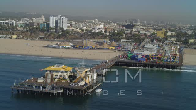 Approach Santa Monica Pier, circus tents on beach, Santa Monica, California Aerial Stock Footage | DCA05_081