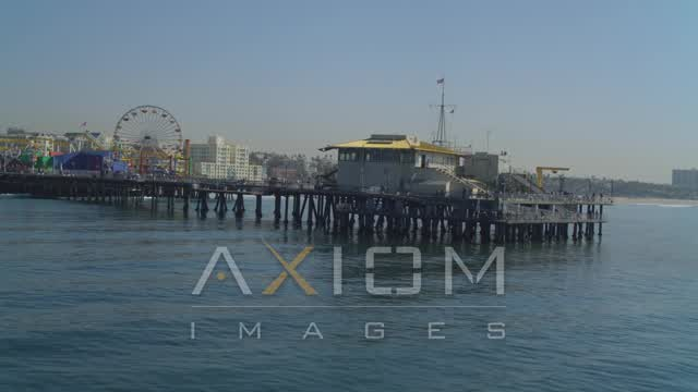 Flying low over ocean, end of the Santa Monica Pier, Santa Monica, California Aerial Stock Footage | DCA05_092