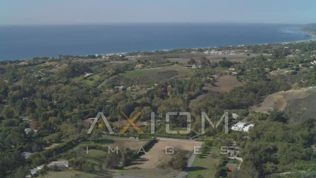 Flying by residential neighborhoods, view of the ocean, Malibu, California Aerial Stock Footage | DCA05_132